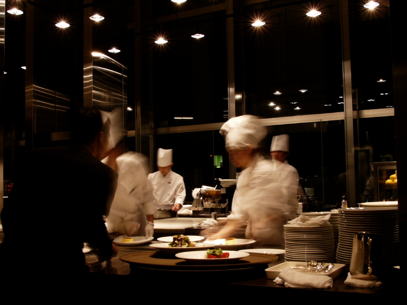 Interior of Lancaster resturant with chefs preparing meals