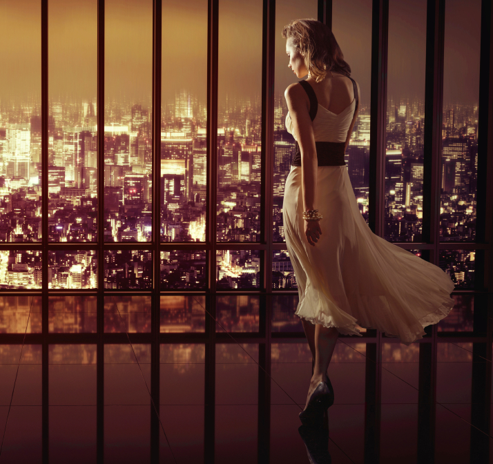 Woman walking and enjoying a view of glamorous city