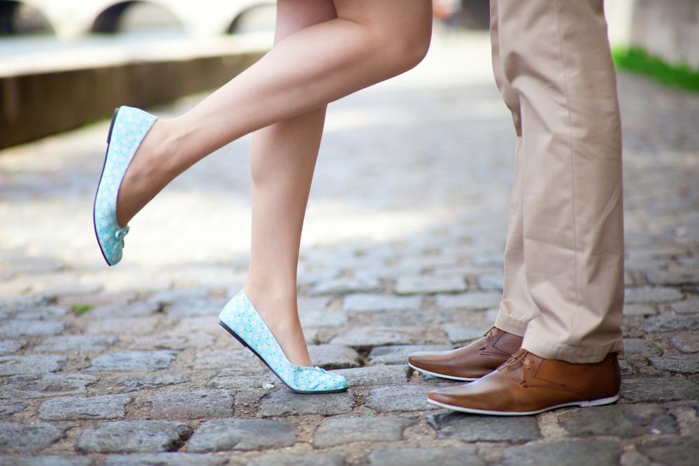 Romantic couples feet on cobblestone street