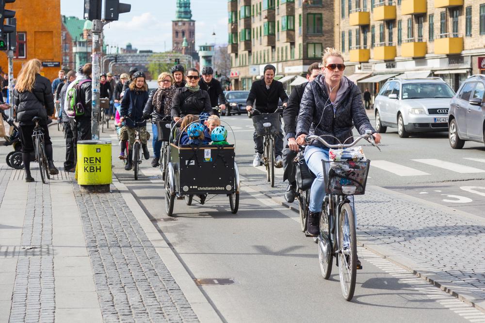 Woman riding a bike in Copenhagen