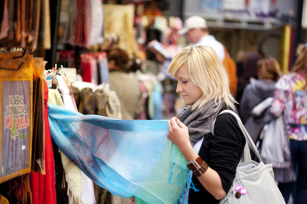 Woman looking at middle eastern goods in a market